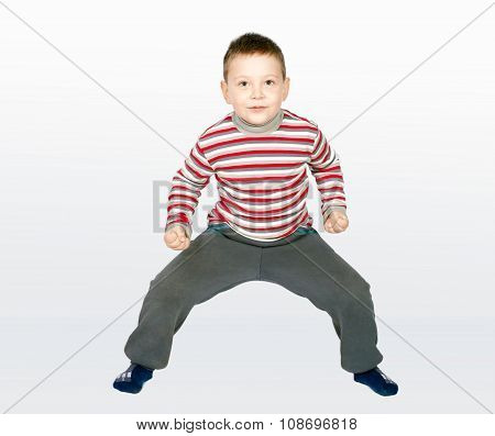 Aggressive little boy on a combined background