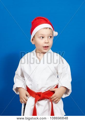 Surprised a little boy in a kimono and wearing Santa hat