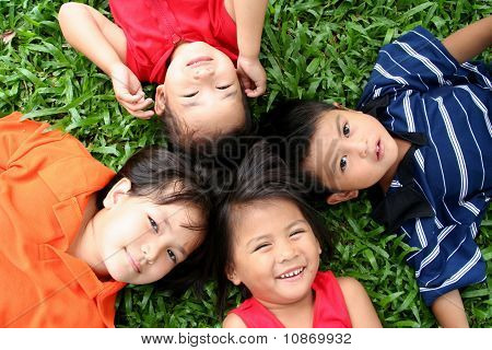 Four girls playing in the park.