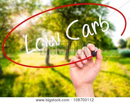 Man Hand writing Low Carb with black marker on visual screen