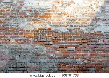 Background old wall of red brick cracked