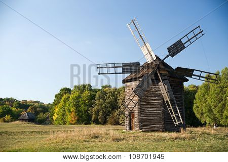 Windmill Standing On The Edge Of The Autumn Forest
