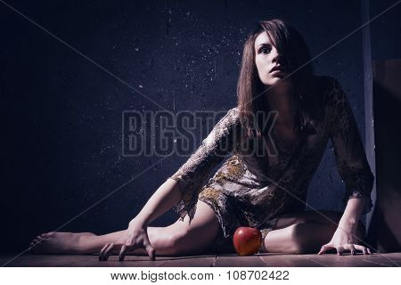 Lonely Mad Woman With Red Apple Sitting On A Floor