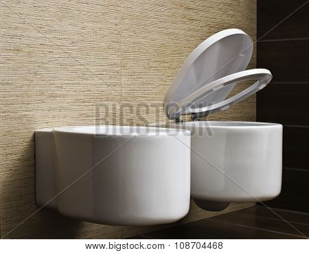 modern toilet with beige tile on wall