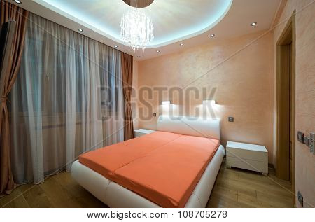 Interior Of A Modern Bedroom With Luxury Ceiling Lights