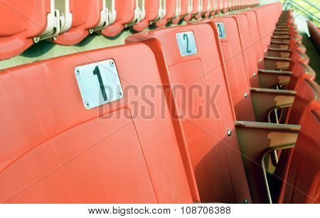 Empty red seating in sport stadium