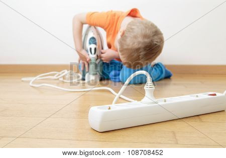 child playing with electricity