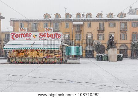 ALBA, ITALY - NOVEMBER 30, 2013: Stall with candies and sweets produced by Sebaste on town square at snowy day. Sebaste is famous manufacturer of traditional italian sweet products, founded in 1885.