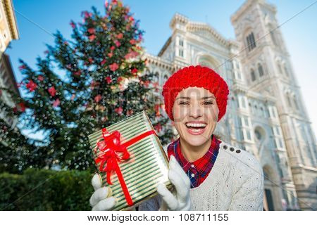 Woman Tourist With Gift Standing Near Christmas Tree In Florence