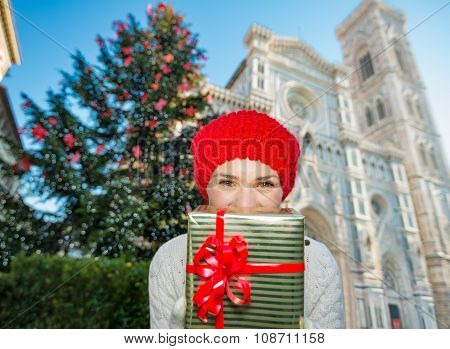 Woman Tourist Hiding Behind Christmas Gift Box In Florence
