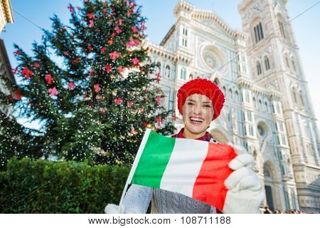 Woman Tourist With Italian Flag In Christmas Decorated Florence