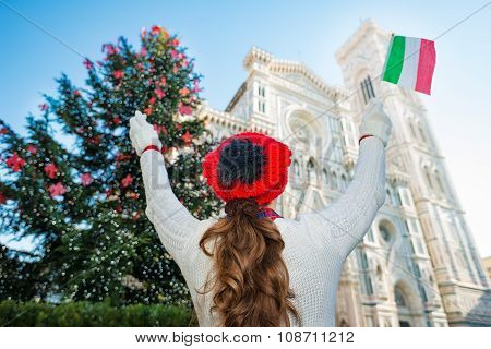 Seen From Behind, Woman Tourist In Christmas Decorated Florence
