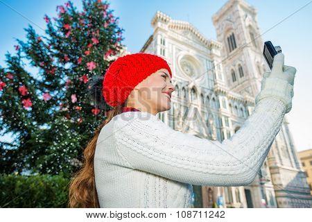 Woman Tourist Taking Photo Near Christmas Tree In Florence