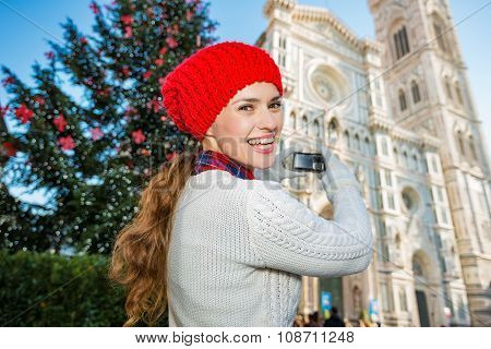 Woman Tourist Taking Photo Of Christmas Decorated Florence