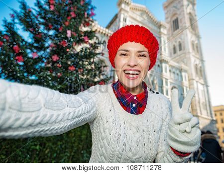 Woman Tourist Making Selfie In Christmas Decorated Florence