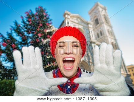 Happy Woman Shouting Near Christmas Tree In Florence, Italy