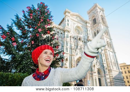 Traveler Pointing On Something Near Christmas Tree In Florence