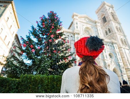 Seen From Behind Woman Enjoying To Be In Italy On Christmas Time