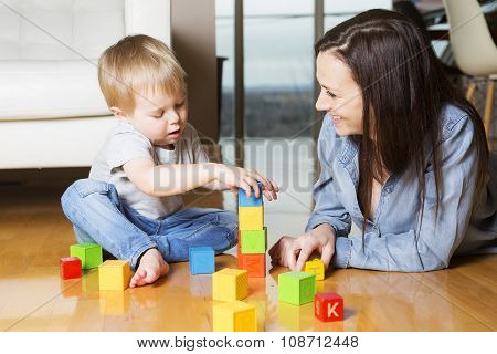mother play block