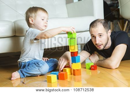 father play block with his son at home