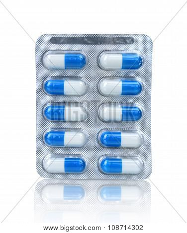 Pills In A Blister Pack Isolated With Reflection