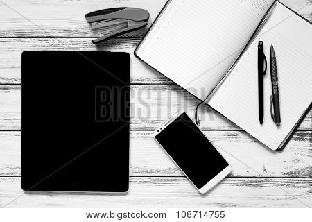 Modern Workplace With Laptop, Pens, Smartphone, Notepad And Stapler On White Wooden Vintage Table Bl