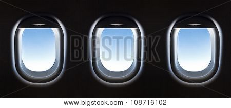 Airplane Window And Fantastic Soft White Clouds Against Blue Sky