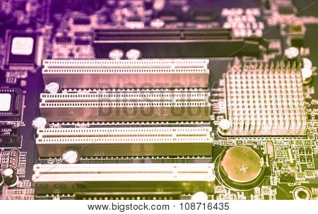 Techno Gradient Violet And Yellow Colors Background Of Computer Motherboard With Blur Effect