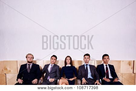 Multi ethnic group of successful entrepreneurs waiting for start business meeting