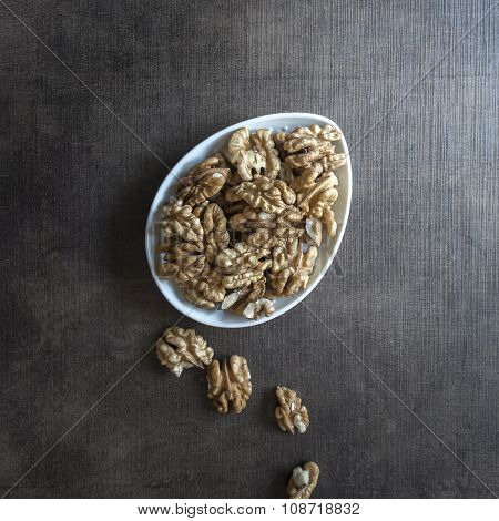 Walnuts On  Wooden Table.