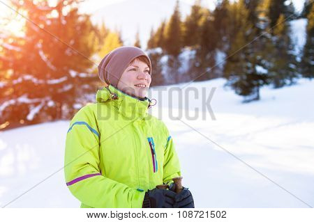 Woman relax in mountains during winter hiking
