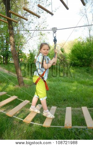 Girl goes on a suspension bridge