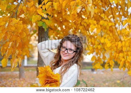 Beautiful Young Woman With Yellow Autumn Wreath On Bright Background