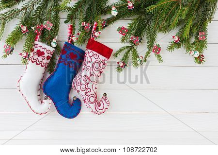 Christmas Background. Colorful Christmas Socks On White Wooden Background With Christmas Fir Tree, C