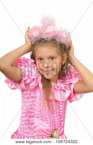 Girl in pink dress with a crown