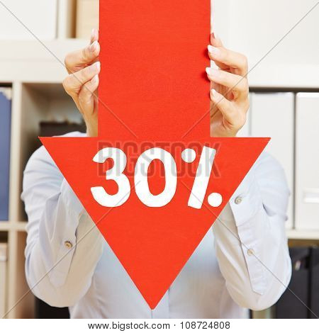 Red arrow with 30% discount being held by female hands