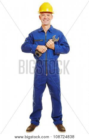 Isolated full body craftsman in boiler suit holding a jaw wrench