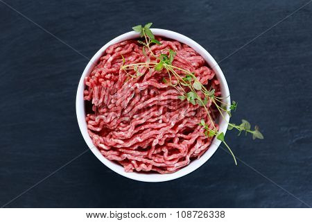 Fresh Raw Mince Beef On Old Blue Stone Background