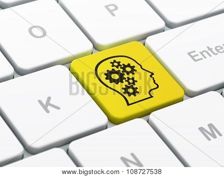 Information concept: Head With Gears on computer keyboard background