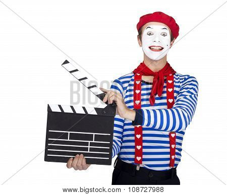 Emotional funny mime actor wearing sailor suit, red beret posing on white background.