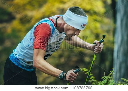 closeup of face athlete running with walking sticks