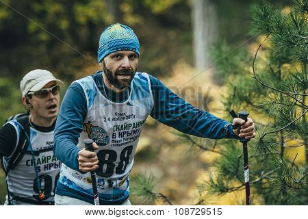 male athlete of middle age closeup with nordic walking poles
