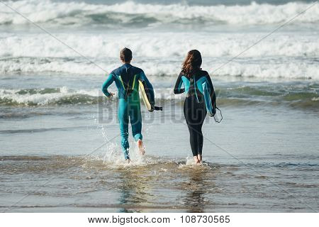 Happy Healthy Bodyboard Surfing Couple