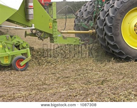 Windrow Of Hay Entering The Baler