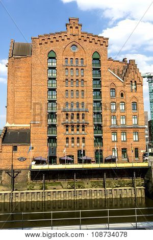 HAMBURG, GERMANY - MAY 6, 2014: Brick-lined red houses at the Speicherstadt Hamburg