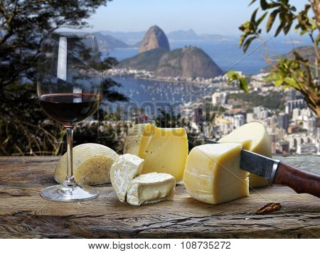 Rio de Janeiro, restaurant overlooking the Sugar Loaf, glass of red wine and assorted cheeses board
