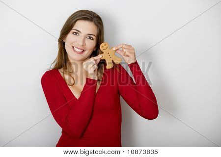 Woman With A Gingerbread Cookie
