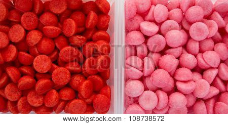 Red And Pink Strawberries Bonbons On White Background