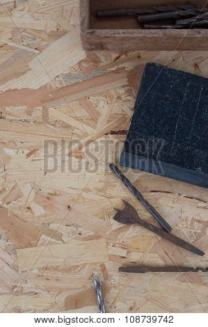 Many Tools Of The Past Under Wooden Background