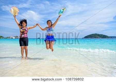 Mother And Daughter Happy On The Beach